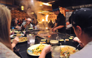 A cook prepares a meal for diners at Fuji Japanese Steakhouse and Sushi in Chubbuck.