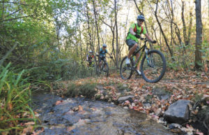 Cyclists ride a trail in City Creek.
