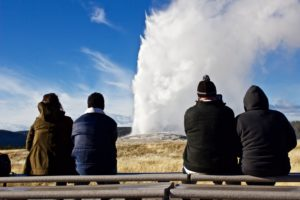 Tourists watch Old Faithful in Yellowstone National Park, which is only a few hours drive away from Pocatello.